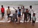 Boys enjoying the seaside at Tiruchendur