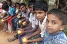 Boys enjoying oranges
