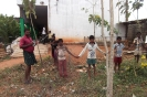 The builder and children marking out the new dormitory